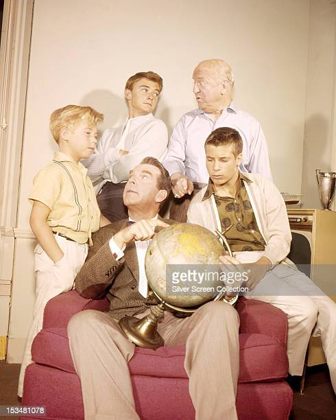 Some of the cast of the TV series 'My Three Sons' circa 1963 Clockwise from left Stanley Livingston Tim Considine William Frawley Don Grady and Fred...