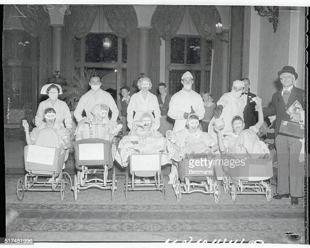 Some of the celeb guest came as the Dionne Quintuplets to a Halloween party given by Betty Grable for Jackie Coogan Standing are Mrs Eddie Eckles Ed...