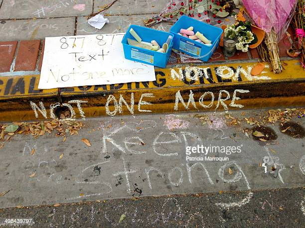 Some of the chalk messages have faded but others remain at a makeshift memorial outside the IV Deli Mart in Isla Vista California UCSB student...