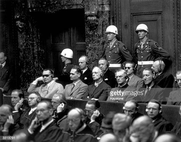 Some of the chief defendants listening to the court summary at the Nuremberg War Trials In the front row are Goering Hess von Ribbentrop Keitel...