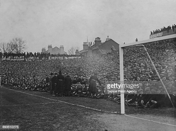 Some of the crowd at Tottenham Hotspur's White Hart Lane ground in London during Spurs' FA Cup Fourth Round Replay against Cardiff 8th March 1922...