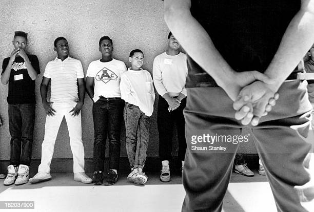 MAY 30 1989 Some of the eight teenagers from Northeast Denver listens to a convict from the Arkansas Valley Prison near ***** way Colo during a...