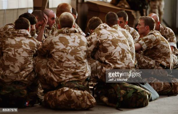 Some of the eighty Royal Marines of Zulu company 45 Commando sit on their bags as they prepare to leave their base RM Condor for six months tour in...