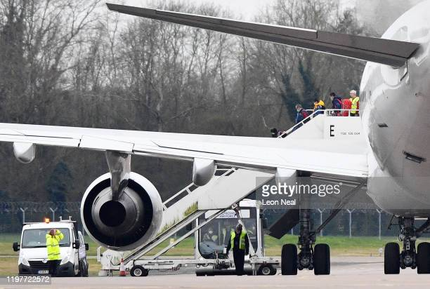 Some of the eightythree Britons and 27 foreign nationals who were trapped in Wuhan following a Coronavirus outbreak disembark a plane RAF Brize...