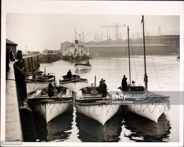 Some of the eleven lifeboats of the Cunard White Star liner 'Queen Mary' after their arrival at Albert Dock in Greenock having left the yard of...