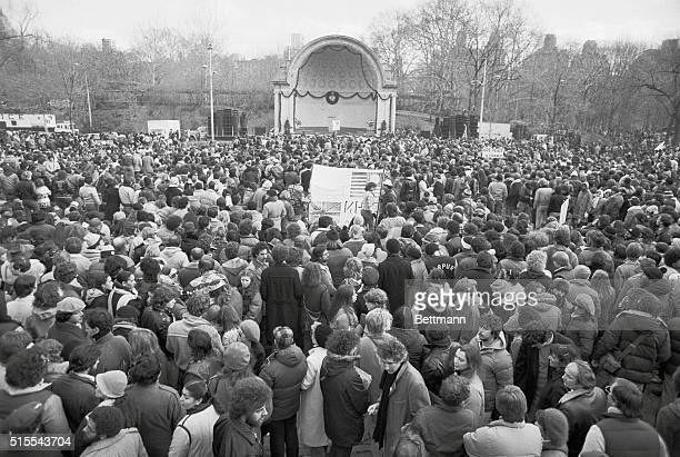 Some of the estimated 50000 persons stand at a silent vigil for slain former Beatle John Lennon in Central Park 12/14 In rear is the band shell with...