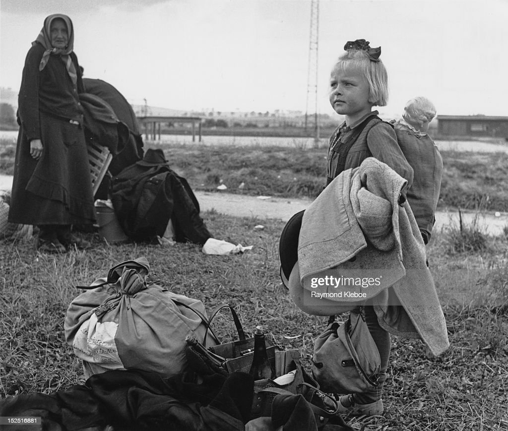 Some of the estimated two and a quarter million Germans who are being expelled from Czechoslovakian territory, after the collapse of German power in 1945. A little girl at the transit camp in Karlovy Vary, formerly Karlsbad. Original Publication: Picture Post - 4163 - A People Moves Out - pub. 17th August 1946