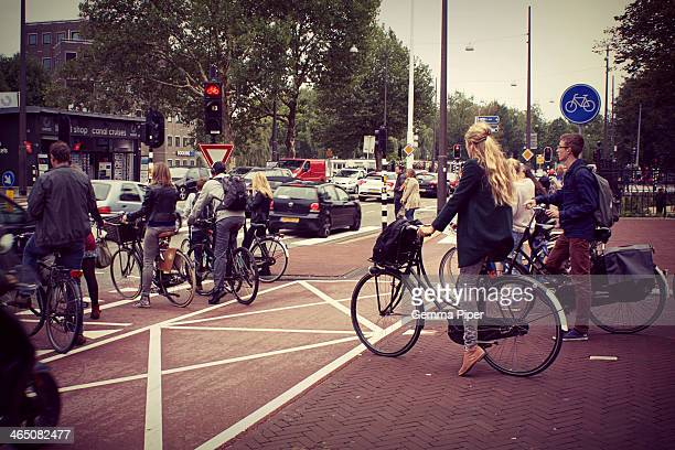 Some of the excellent segregated cycling paths and infrastructure in Amsterdam and its everyday bicycle users during rush hour.