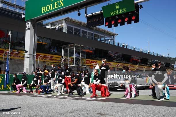 Some of the F1 drivers take a knee on the grid in support of the Black Lives Matter movement ahead of the Formula One Grand Prix of Austria at Red...