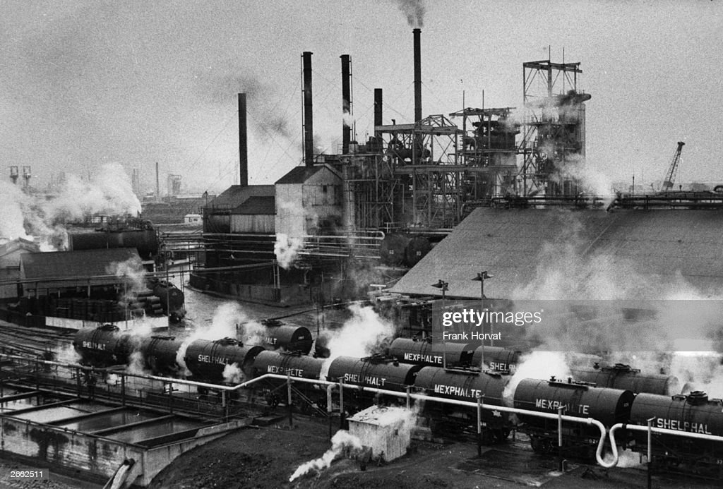 Some of the factories lined along the Manchester ship canal. Original Publication: Picture Post - 7538 - Manchester's Lifeline - pub. 1955