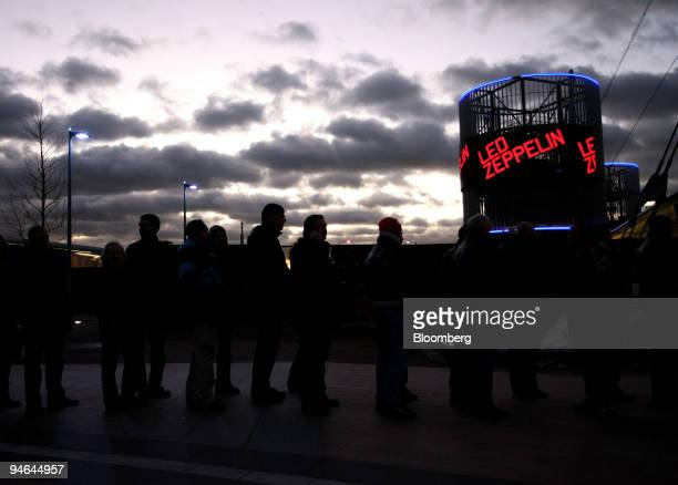 Some of the fans line up to collect their tickets to see Led Zeppelin in concert at the O2 arena in London, U.K., on Monday, Dec. 10, 2007. More than...