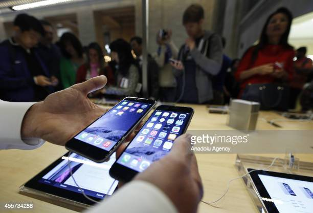Some of the first customers at the Fifth Avenue Apple store try out the new iPhone 6 in New York United States on 19 September 2014 The new iPhone 6...