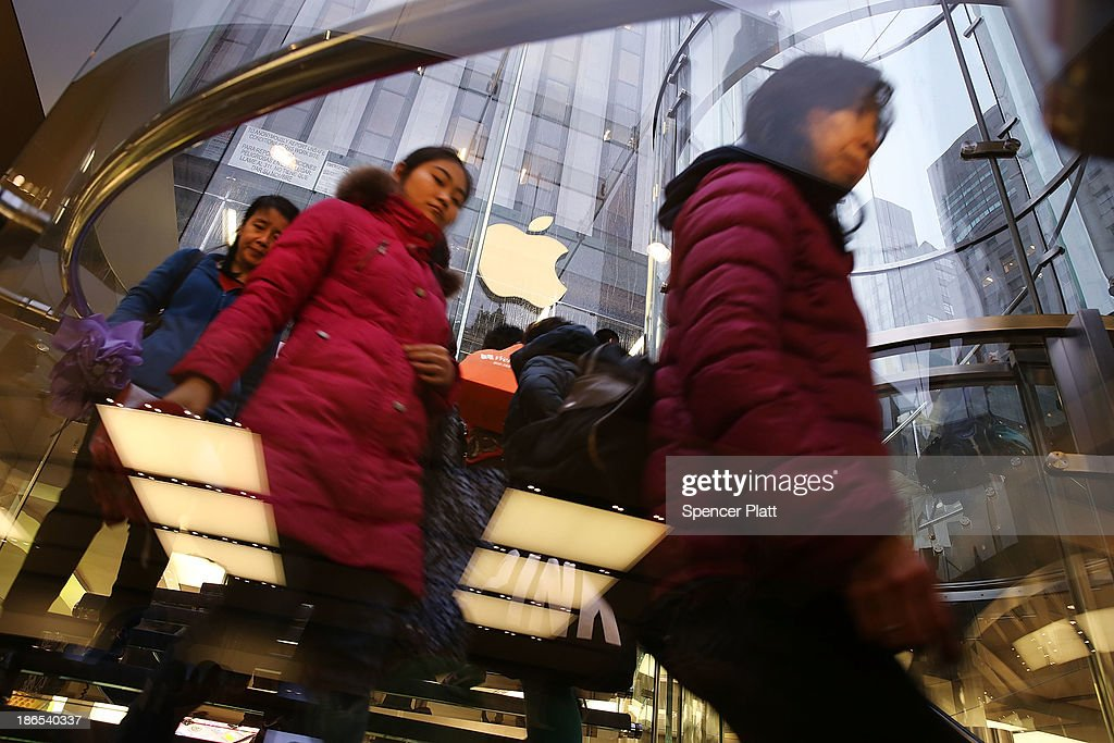 Some of the first customers in line walk into the Apple Store to purchase the new iPad Air, the fifth generation of its tablet on November 1, 2013 in New York City. The new iPad, which will also come in a mini version, is 20% thinner and 28% lighter than the current fourth-generation iPad. It has the same 9.7-inch screen as previous iPads and uses the same A7 processing chip that's in the iPhone 5S. The iPad Air, which went on sale today, will start at $499 for a 16GB Wi-Fi-only model and go up to $629 for a 16GB with 4G LTE connectivity.