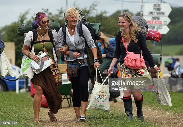 Some of the first festival revellers smile as they arrive at the Glastonbury Festival at Worthy Farm Pilton on June 25 2008 in Glastonbury Somerset...