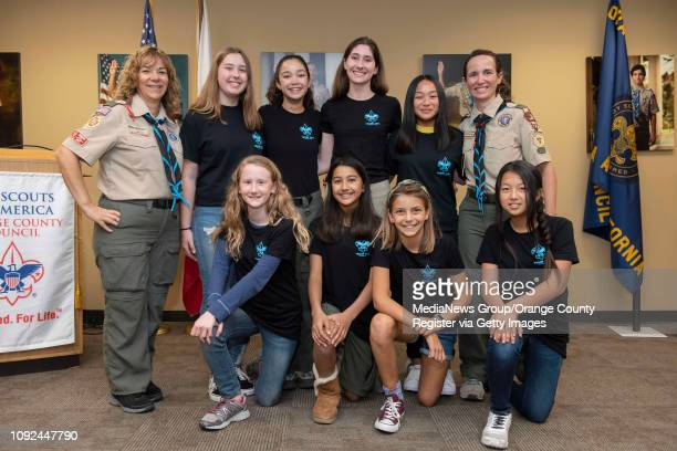 Some of the founding members of Boy Scout Troop 7272 the first allgirls troops in the county pose for a photo at Boy Scouts of America's Orange...