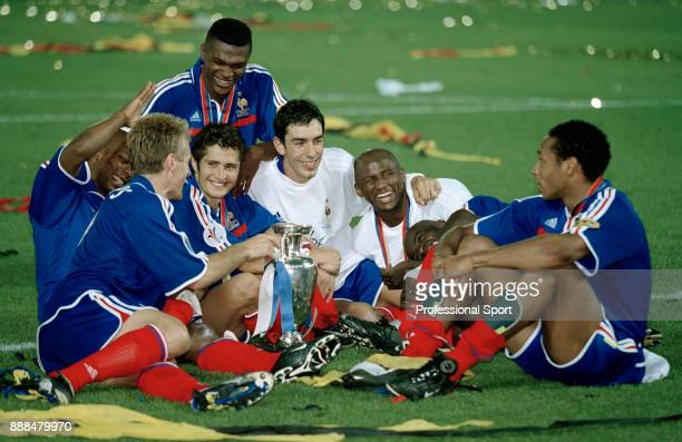 Some of the French team celebrate with the trophy after victory in the UEFA Euro 2000 Final between France and Italy at the Feijenoord Stadium on...