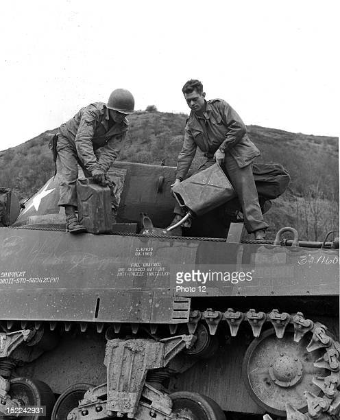 Some of the gasoline brought up by plane for the speeding columns of the 3rd US Army is poured into a medium tank at a forward armored depot in...