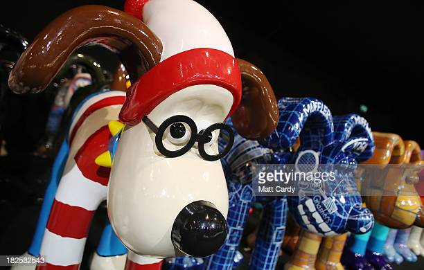 Some of the giant Gromit sculptures that have been decorated by artists celebrities are seen as they wait in a secret location before being auctioned...