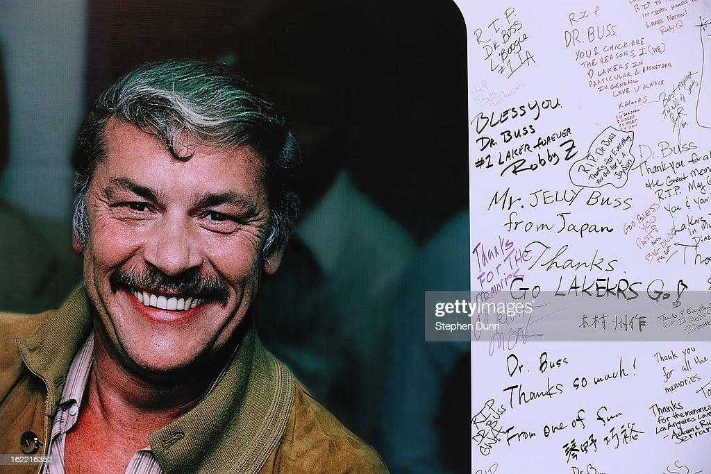 Some of the good wishes of fans adorn a wall near Staples Center in honor of the late Dr. Jerry Buss, owner of the Los Angeles Lakers, before the game against the Boston Celtics on February 20, 2013 in Los Angeles, California.