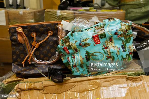 Some of the items of counterfeit goods in a warehouse at Southampton docks seized by the Border Force including fake Louis Vuitton and Cath Kidston...