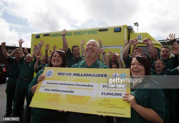Some of the members of a syndicate of 69 ambulance service workers celebrate winning 1 million GBP in last Friday's EuroMillions draw which created a...