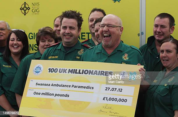 Some of the members of a syndicate of 69 ambulance service workers celebrate winning 1 million GBP in last Friday's EuroMillions draw, which created...