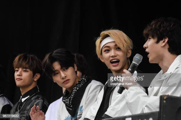 Some of the members of Stray Kids a popular Korean band answer questions on stage at a convention called Kcon that brings together some of the most...