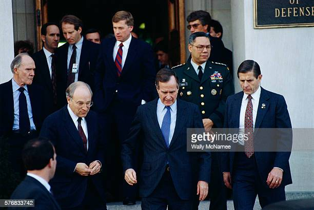 Some of the members of the United States National Security Council leave the Pentagon including Vice President Dan Quayle and National Security...
