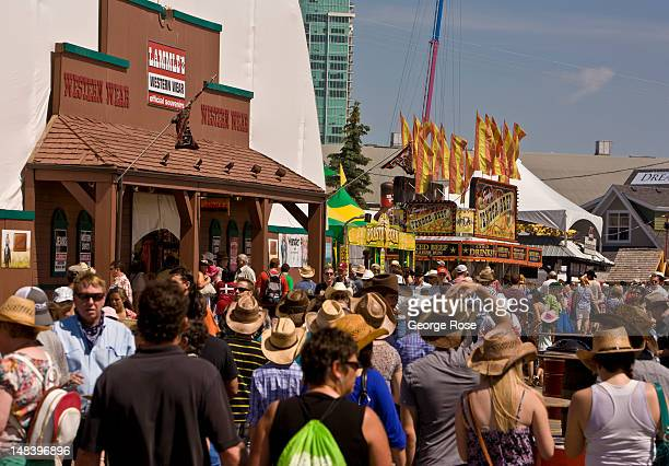 Some of the more than 108000 people attending on the first day are viewed on July 6 2012 in Calgary Canada Calgary Stampede the world's largest...