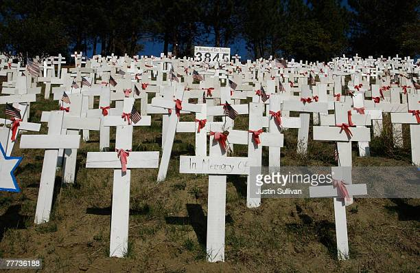 Some of the nearly 4000 wooden crosses that represent US troops that have been killed in Iraq stand at a roadside memorial November 6 2007 in...