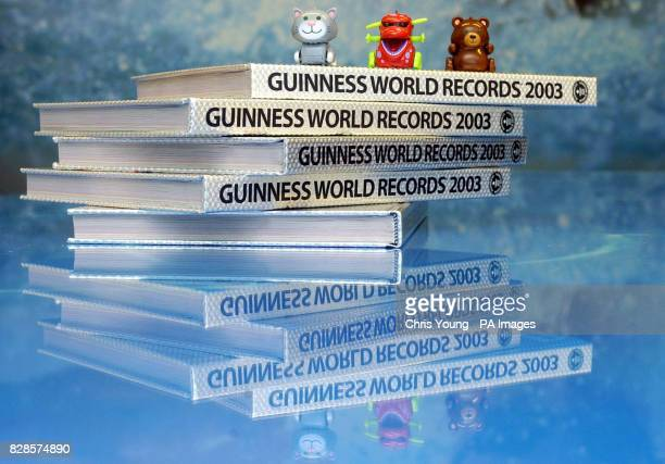 Some of the original micro pets Chumsley Yuk and Kuma sit on top of copies of the Guinness Book of Records in central London after the Tomy toys were...