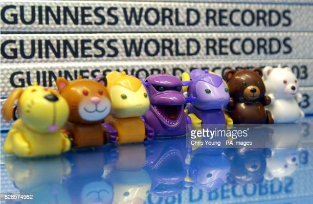 Some of the original micro pets sit next to copies of the Guinness Book of Records in central London after the Tomy toys were officially awarded a...