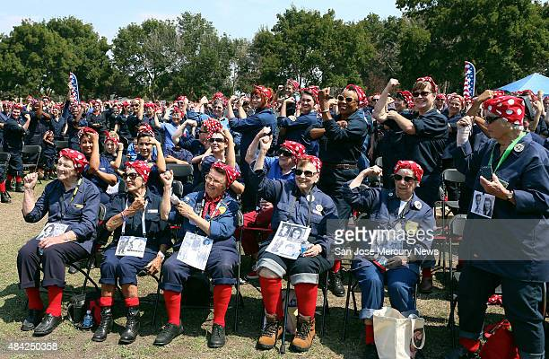 Some of the original Rosie the Riveter women sitting in the first row who worked in the Richmond shipyards during WWII join hundreds of women dressed...