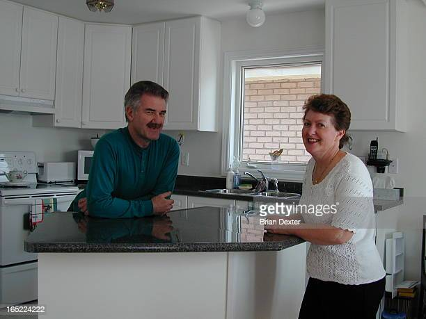 Some of the people who have bought bungalows in Drury Park a new adult community in Milton 1 John and Kay Best on porch with forested background She...