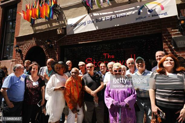 Some of the people who were at the Stonewall Inn the night the historic gay bar was raided by police on June 28, 1969 gather for a photo shoot in...