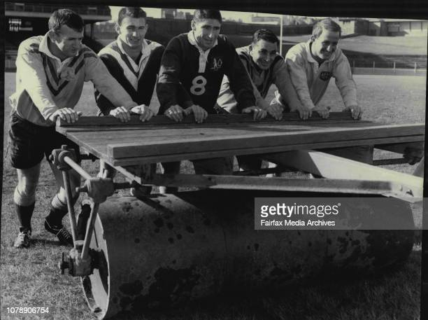 Some of the players help push the heavy roller on SCG No 1 before training on No 2 groundFive of the NSW Rugby League players for the match against...