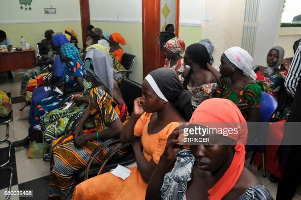 Some of the recently freed girls from Chibok wait in Abuja on May 7 2017 Eightytwo of the more than 200 schoolgirls kidnapped by Boko Haram in...