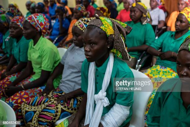 Some of the recently released girls from Chibok wait in Abuja on May 8 2017 The United Nations on May 8 2017 welcomed the release of 82 Nigerian...