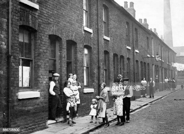 Some of the residents in a street in Pendleton, Greater Manchester. July 1932.