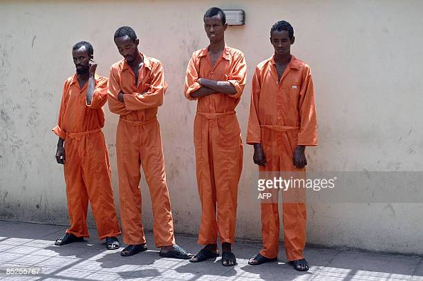 Some of the seven Somali pirates are pictured after being arreseted on March 5 2009 in the Kenyan port of Mombasa as they await their trial tomorrow...