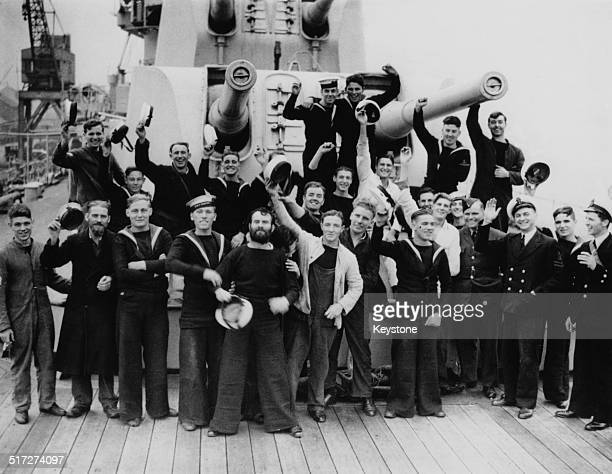 Some of the the crew of the British Royal Navy Leanderclass light cruiser HMS Ajax in Plymouth on their return from the Battle of the River Plate in...