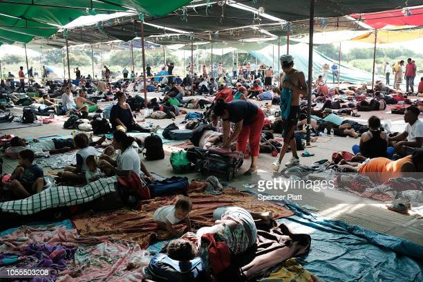 Some of the thousands of Central American migrants in the caravan rest at a camp for the evening on October 30, 2018 in Juchitan de Zaragoza, Mexico....