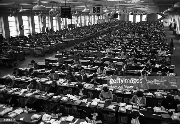 Some of the thousands of staff employed by Littlewoods to deal with the football forecasts and to pay out the weekly dividends Original Publication...