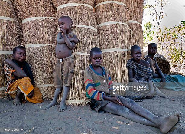 Some of the twelve children of father Martin Ochen five of whom are suffering from a mystery ailment known as nodding disease are pictured close to...