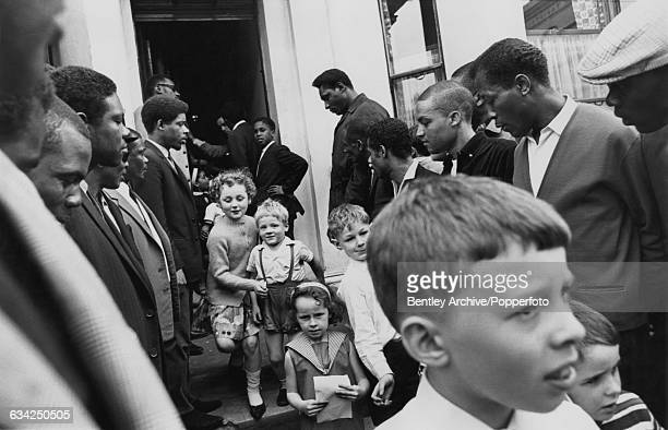 Some of the twenty four members of the Racial Adjustment Action Society providing a bodyguard for world heavyweight boxing champion Cassius Clay...