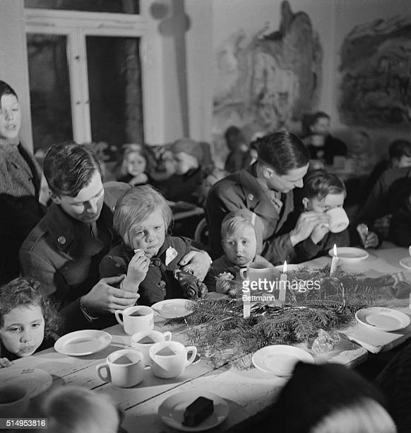 Some of the two hundred German children and children of displaced persons who were entertained by American soldiers at a Christmas party in Berlin...