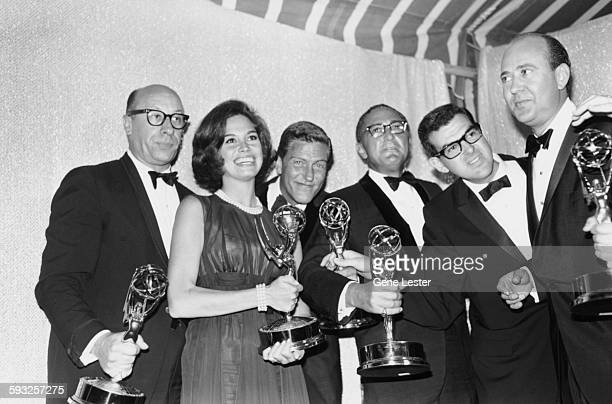 Some of the winners at the Emmy Awards holding their statuettes Richard Deacon Mary Tyler Moore Dick Van Dyke Sheldon Leonard and Carl Reiner Los...