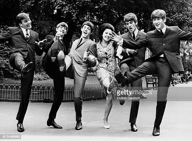 Some of the winners of the 1963 Melody Maker poll awards give a high kick for their success Susan Maugham was voted top female singer on the far left...