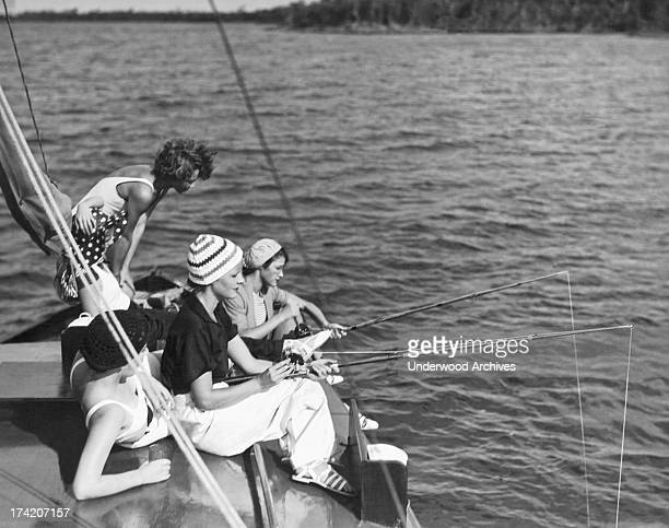Some of the younger members of the Key Largo Anglers Club fishing offshore on a sailboat near the club Key Largo Florida 1927