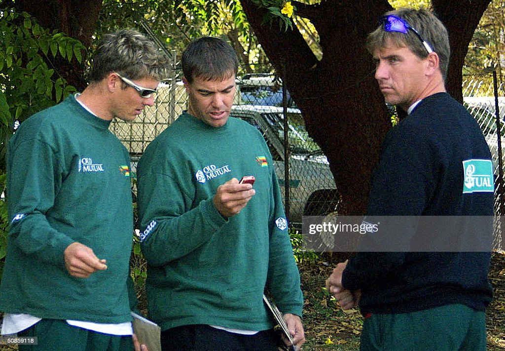 Some of the Zimbabwean cricketers at odds with the Zimbabwe Cricket Union (ZCU), Andy Blighunt (L), former captain Heath Streak (C) and Raymond Price, wait 20 May 2004 outside ZCU offices as their representatives negotiate with the union.